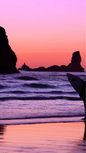 Surfer at Sunset, Cannon Beach, Oregon iPhone 8 wallpaper